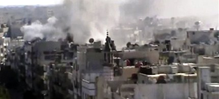 This image made from amateur video released by Shaam News Network purports to show explosions in the Khaldiyeh area of Homs, Syria. (photo: AP)