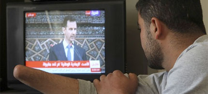 A Syrian pro-democracy activist, his hand cut off he says by Syrian security forces, watches Syria's President Bashar al-Assad on TV, 06/03/12. (photo: Reuters)