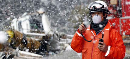 A rescue worker near the Fukushima Nuclear Plant last March. (photo: Corbis)