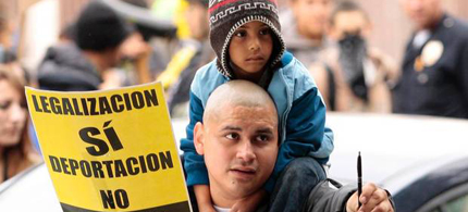 An immigration protester carries a child on his shoulders during May Day demonstrations in Los Angeles, California in this file photo taken May 1, 2012. (photo: Jason Redmond/Reuters)