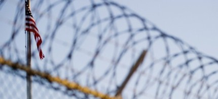 The flag and barbed wire within a detention facility at Guantanamo Bay. (photo: Getty Images)
