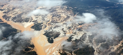 Aerial view of the infamous Rio Huaypetue gold mine in the Peruvian Amazon. This remote but massive gold mine is known for the destruction of primary rainforest, widespread mercury pollution, and child and slave labor. (photo: Rhett A. Butler)