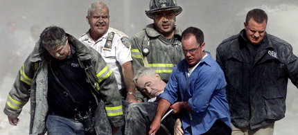 Rescue workers carrying Father Judge who died while reading last rites to a fireman on 9/11. (photo: Getty Images)