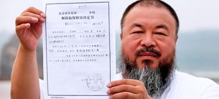 Ai Weiwei holds the government document informing him of the expiry of his bail term, in Beijing today. (photo: Ed Jones/AFP/Getty Images)