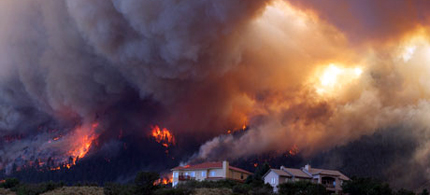 The Waldo Canyon wildfire burns as it moved into subdivisions and destroyed homes in Colorado Springs, 06/27/12. (photo: Galon Wampler/AP)