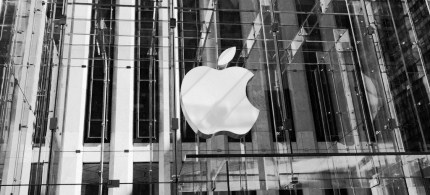 Apple pays it's 30,000 store workers around $12 per hour, while nine of the company's top executives made a total of $441 million in 2011. (photo: Zastavki)
