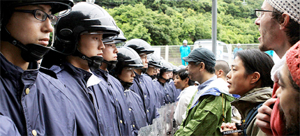 Anti-nuclear activists stand in front of a line of police officers during a protest in Fukui. (photo: Jiji Press/AFP/Getty Images)