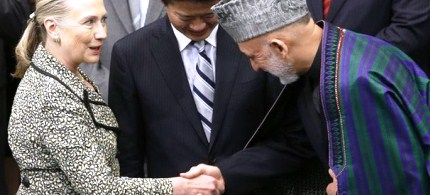 Secretary of State Hillary Clinton shakes hands with Afghan President Hamid Karzai during the Tokyo Conference on the Reconstruction of Afghanistan, 07/08/12. (photo: Reuters)
