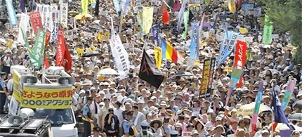 Anti-nuclear energy protesters march on a street in Tokyo Monday, July 16, 2012. (photo: Koji Sasahara/AP)
