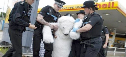 Dressed as polar bears, Greenpeace protesters targeted Shell petrol stations across the UK to protest the company's plans to drill for oil off the coast of Alaska. (photo: BBC News)