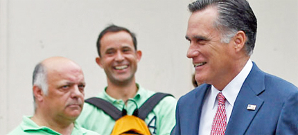 Mitt Romney is eyed by pedestrians as he was forced by gridlock traffic to walk from his hotel to the Irish embassy. (photo: Jason Reed/Reuters)