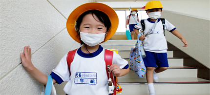 Students wear masks at an elementary school outside of the 20-km (12 mi) radius zone from the crippled Fukushima Daiichi nuclear power plant in Minami Soma, Fukushima Prefecture, on September 8, 2011. A line dividing the no-go zone around the Fukushima nuclear plant and the area deemed safe from radiation cuts right across this coastal city but the 'good' part is starting to look very much like the ghost town on the other side. Six months after a magnitude 9.0 earthquake unleashed a deadly tsunami that triggered meltdowns and radiation leaks at the Tokyo Electric Power's complex, Minami Soma, a city just a half an hour's drive away, struggles to stay alive. (photo: Kim Kyung-Hoon/Reuters)