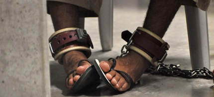 A Guantanamo detainee's feet are shackled to the floor as he attends a 'Life Skills' class inside the Camp 6 high-security detention facility at Guantanamo Bay U.S. Naval Base. (photo: Reuters)