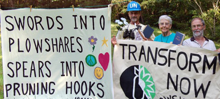 The Transform Now Three with their signs. (photo: Transform Now Plowshares)