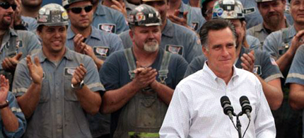 Mitt Romney speaking at a rally with coal miners in the background. (photo: Reuters)