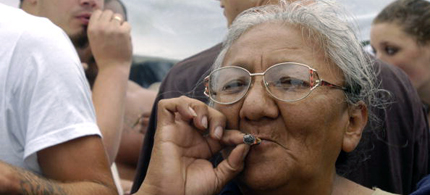An elderly women smokes a joint at hemp fest. (photo: The Washington Post)