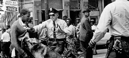 A civil rights protester attacked by a police dog in Birmingham, Alabama, in 1963. (photo: Bill Hudson/AP)