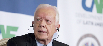 Former president Jimmy Carter, seen here speaking in Washington last week, warned against the 'excessive influx of money' in U.S. politics, particularly because of the Citizens United ruling. (photo: Manuel Balce Ceneta/AP)