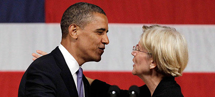 President Barack Obama leans in to kiss Massachusetts senatorial candidate Elizabeth Warren after she introduced Obama before he addresses supporters during a June campaign fundraiser at Symphony Hall in Boston. (photo: Stephan Savoia/AP)