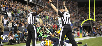 The messed-up ending of the Seattle-Green Bay game Monday night, the strongest reason so far for the NFL to get the real refs back on the field. (photo: Otto Greule Jr./Getty Images)