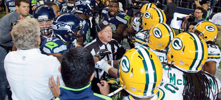 Replacement NFL referee Richard Simmons breaks up an altercation between the Seattle Seahawks and the Green Bay Packers after the game. (photo: Steven Bisig/US Presswire), From ImagesAttr