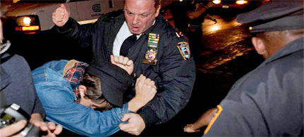 NYPD beats Occupy protester with fist in Zuccotti Park, 11/15/11. (photo: AP/SA)