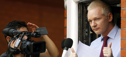 WikiLeaks founder Julian Assange gestures after his statement to the media and supporters on a balcony of the Ecuadorian Embassy in London Aug. 19, 2012. (photo: AP)