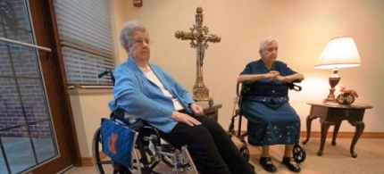 Retired nuns Jeanne Gallagher and Pauline Kelly talk about voter identification for this year's election. (photo: Butch Comegys)