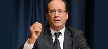 Francois Hollande has described the 2013 plans as a 'combat budget.' (photo: Andrew Gombert/EPA)