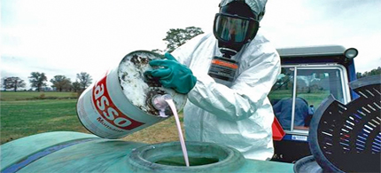 Monsanto pesticide to be sprayed on crops. (photo: Waking Times)
