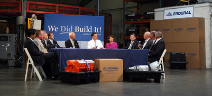 Mitt Romney holds a small business roundtable in a warehouse. Notably absent, employees. (photo: David McNew/Getty Images North America)