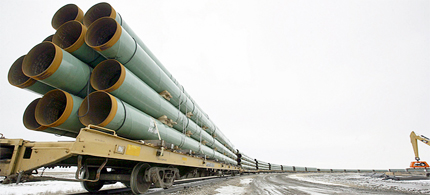 Rail cars arrive in Milton, N.D., loaded with pipe for TransCanada's Keystone Pipeline project in this 2008 photo. The Keystone pipeline is expected to be offline for three days while the company goes in for a closer look after a 'small anomaly' was found outside the pipe. (photo: Eric Hylden/Grand Forks Herald/Canadian Press)