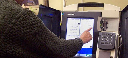 Companies with ties to the Romneys own a lot of voting machines. (photo: Getty Images)