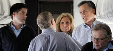Mitt, Ann and Tagg Romney confer with aides on a campaign flight. (photo: TopekaNews)