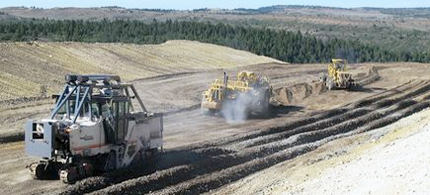 Once the bitumen seam is exposed, U.S. Oil Sands will use a surface miner similar to this one to extract the bitumen. (photo: InsideClimate News)
