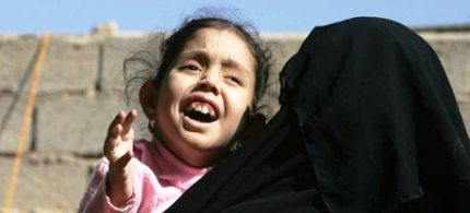 Mariam Yasir, aged 6 (in 2009), with her mother in Fallujah, Iraq; Mariam suffers from a birth defect. (photo: Muhannad Fala'ah/Getty Images)