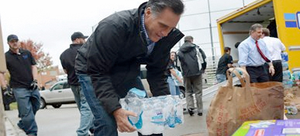 Romney lifts water for photo op. (photo: Emmanuel Dunand/AFP/Getty Images)