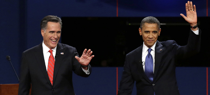 Republican presidential candidate Mitt Romney and President Barack Obama wave to the audience during the first presidential debate at the University of Denver in Denver. (photo: AP)