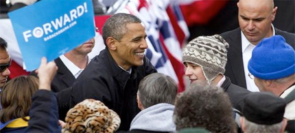 President Obama greets people after addressing supporters at a campaign rally November 5, 2012 in Madison, Wisconsin. With only one day left until the presidential election, Obama is making final campaign appearances in Wisconsin, Iowa and Illinois. (photo: Mark Hirsch/Getty Images)