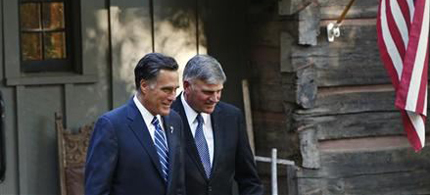 Republican presidential nominee Mitt Romney leaves the home of Reverend Billy Graham (not pictured) with Graham's son Franklin (R), in Montreat, North Carolina, October 11, 2012. (photo: Shannon Stapleton/Reuters)