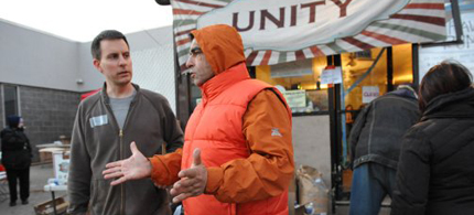 Salvatore LoPizzo, right, turned his social welfare group into a hurricane relief hub with the help of Occupy volunteers in Rockaway Beach. (photo: Alice Proujansky)