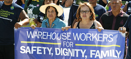 Maria Elena Durazo, executive secretary-treasurer of the Los Angeles County Federation of Labor, and United Farm Workers co-founder Dolores Huerta marched side by side with Walmart warehouse workers demanding safer working conditions in Downtown Los Angeles on September 18, 2012. (photo: Loren Townsley)