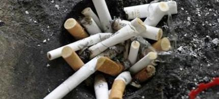 Cigarette butts in an ashtray in Los Angeles. (photo: Jonathan Alcorn/Reuters)