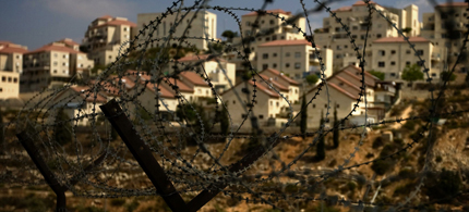 The West Bank Jewish settlement of Beitar Ilit is seen through a barbed wire fence, Prime Minister Benjamin Netanyahu is expected to push for new housing units in response to the UN vote on Palestinian statehood. (photo: Sebastian Scheiner/AP)