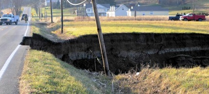 The 200 foot long sinkhole in Ohio is approximately eighty-five feet deep as well as a hundred feet wide. (photo: Times Reporter)