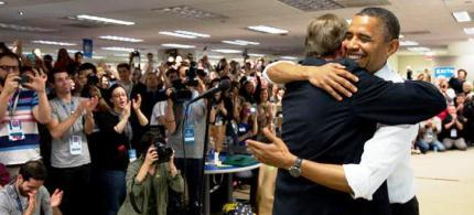 President Obama hugs his campaign manager Jim Messina at campaign head