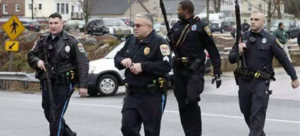 Paragould, Arkansas Mayor Mike Gaskill and Police Chief Todd Stovall announced at a December 14 Town Hall meeting that beginning in 2013 the streets of their city were going to be patrolled by police officers bearing SWAT gear and AR-15s. (photo: Disclose TV)