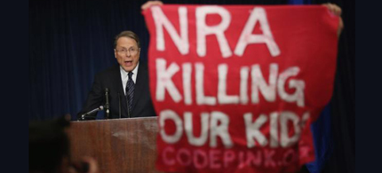 National Rifle Association Executive Vice President Wayne LaPierre is interrupted by protesters from Code Pink. (photo: Chip Somodevilla/Getty Images)