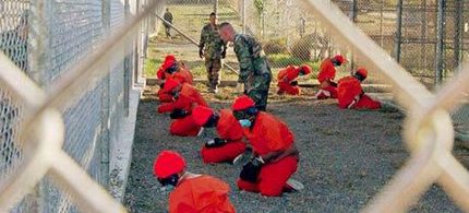 Detainees in Guantanamo Bay. (photo: Reuters)