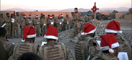 In this 2008 photo, thousands of miles from their loved ones, Royal Marines sing Christmas carols in Afghanistan - moments before Taliban forces staged a surprise attack. (photo: Capt. Euan Goodman)